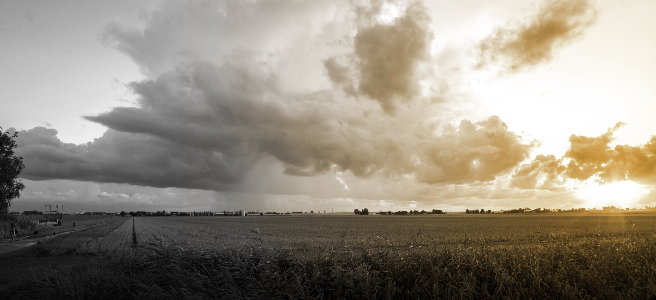 Scenic view of a thunderstorm over wide open flat landscape at sunset